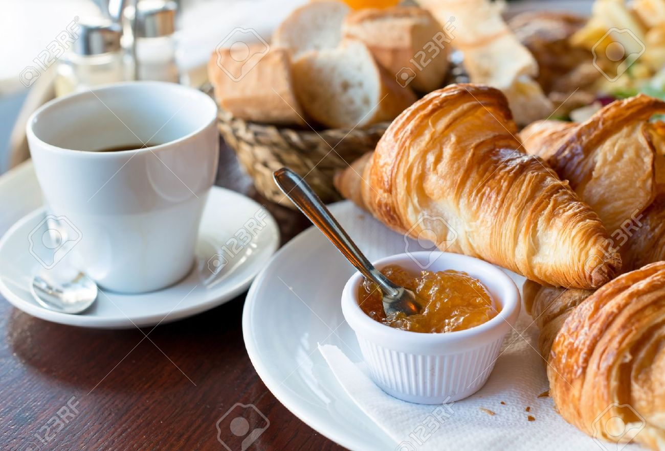 13656877-breakfast-with-coffee-and-croissants-in-a-basket-on-table.jpg